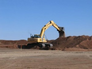 Kevin Welch / Amarillo Globe-News - Golden Spread Panhandle Wind Ranch excavator digs the hole for a wind turbine